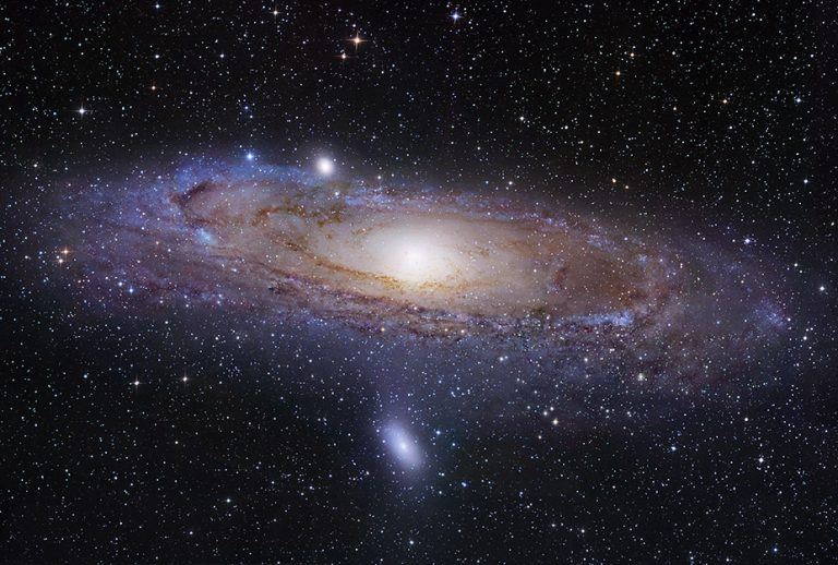 M31, the Andromeda Galaxy, image by Robert Gendler (2008). Both Hubble & Baade made their principal discoveries by observing M31 with the 100-inch telescope, at Mt. Wilson Observatory. Hubble made his observations where the blue stars are, in the outer ring. He could not resolve individual stars in the yellow central bulge. Baade could resolve individual stars in the central bulge. The blue outer arms are made up of population I stars. The yellow looking central bulge is made up of population II stars, and Baade was the first to discover that difference.