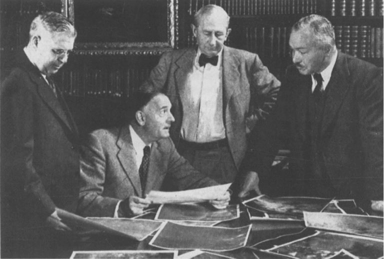 Milton L. Humason, Edwin Hubble, Walter Baade, and Rudolph Minkowski, examining direct photographs taken with the 48-inch Schmidt telescope, at Palomar Observatory. Carnegie Observatories Library, 1950 (courtesy of the Hamburg Observatory)